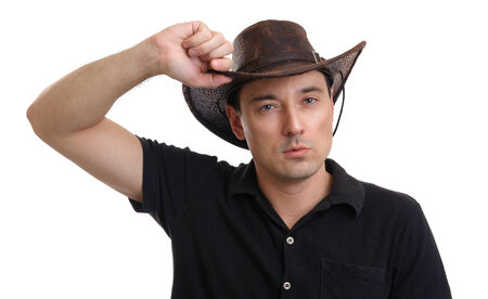 sexy cowboy: handsome man wearing cowboy hat. Isolated over white