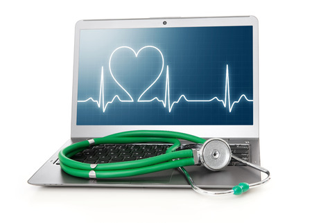 laptop with heart rhythm ekg on screen and stethoscope photo