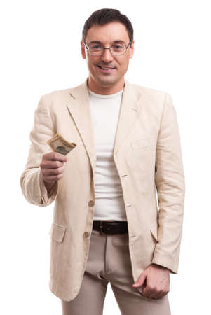 giving money: Handsome business man giving money isolated on white background