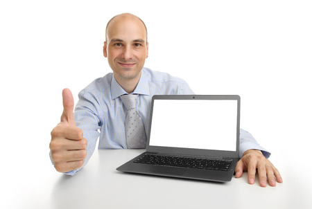 sit up: Smiling businessman showing laptop computer with blank screen Stock Photo