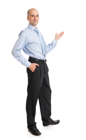 pointing hand: Happy Young Businessman Presenting Isolated Over White Background