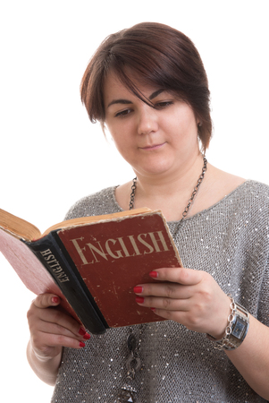 learning english: learning English concept. Young woman reading a book Stock Photo