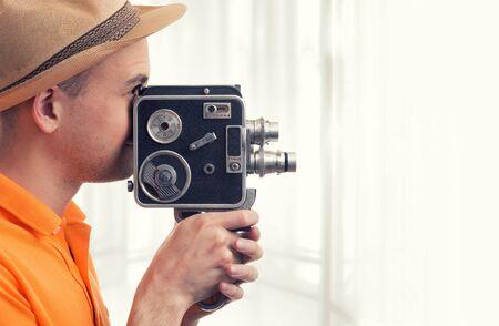 film: cameraman make film on a retro camera