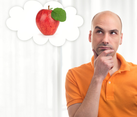 thinking man: Portrait of handsome man dreams about apple Stock Photo