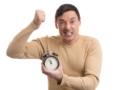 despaired: Yelling man with alarm clock in his hand