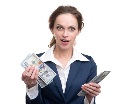 woman holding money: young business woman holding money. Isolated over white
