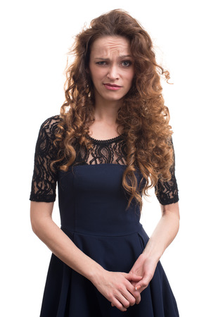 sceptic: confused woman with curly hair isolated on white background Stock Photo
