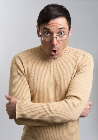 stupor: portrait of surprised man over gray background Stock Photo