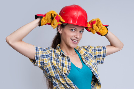 sexy construction worker: Sexy young woman construction worker. Studio shot