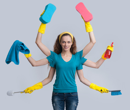 housewife with six hands multitasking her cleaning. Isolated on gray