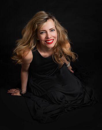 sensuality: portrait of a beautiful sensuality woman in black dress posing