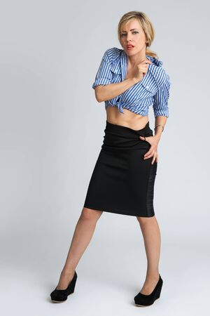 sexy businesswoman: sexy businesswoman isolated on gray background in full body Stock Photo
