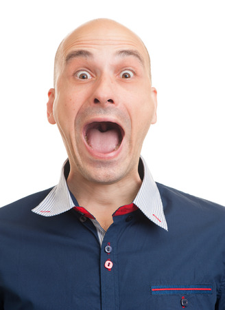 wail: Portrait of a young bald man screaming. Isolated