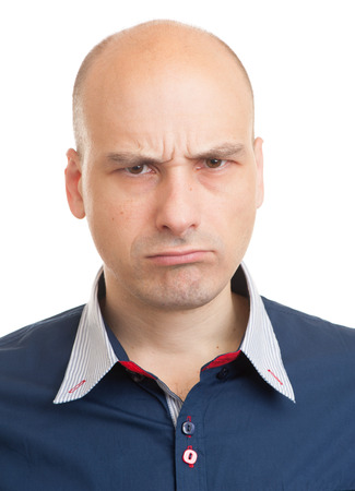 enraged: close up portrait of Angry bald man. Isolated Stock Photo