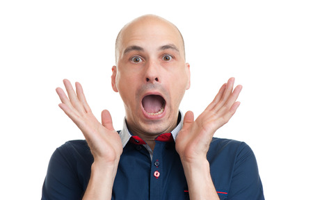 facial expression: Portrait of young bald man with shocked facial expression, isolated over white background
