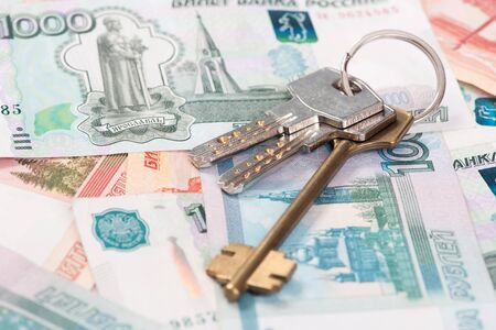 economic rent: House keys and Russian banknotes close up Stock Photo