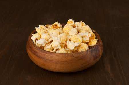 popcorn bowls: popcorn in a wooden bowl close up