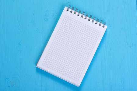 spiral notebook: Open Spiral Notebook with copy space on wooden background