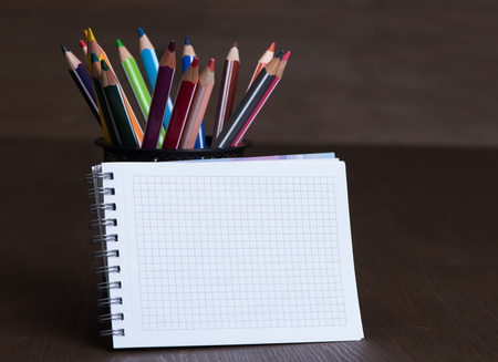 back to school supplies: Blank Note Pad with copy space and colorful Pencils
