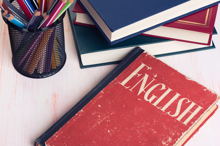 back to school supplies: Learning English. Education concept. Book and school supplies
