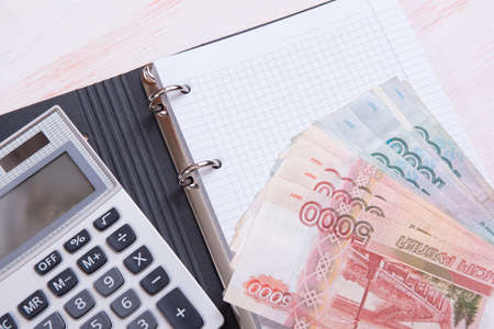 blank space: money, calculator and blank notebook with copy space Stock Photo