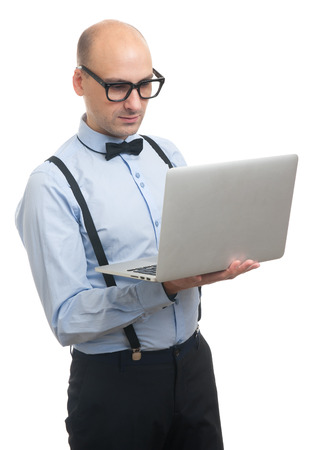 suspenders: Handsome guy with suspenders and bow-tie working on laptop