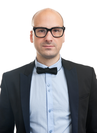 beau mec: Handsome guy with glasses and bow-tie. Studio shot Banque d'images