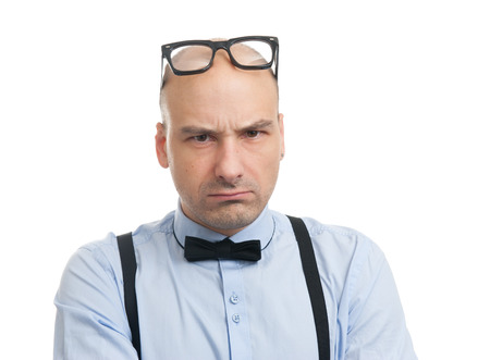 suspenders: angry man with suspenders and bow-tie. Studio shot Stock Photo
