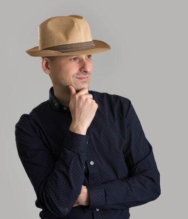 fedora: smiling man wearing fedora hat isolated over grey