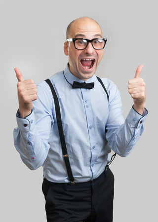 suspenders: funny bald man wearing bow tie and suspenders showing thumbs up