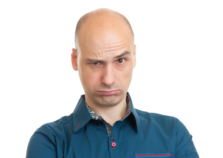 grouchy: handsome bald man isolated on white background Stock Photo