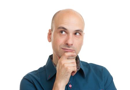 handsome bald man thinking isolated on white background
