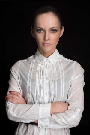 ooking: Beautiful Brunette Girl. caucasian woman low key portait over dark background