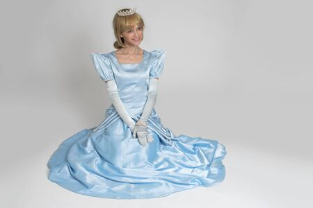 beautiful cinderella: fairytale princess. Portrait of happy woman in crown and dress Stock Photo