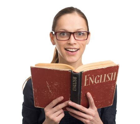english book: Nerd woman reading an English book isolated on a white background Stock Photo