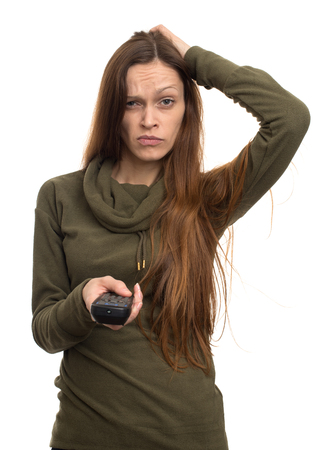 remote controls: serious woman on a white background remote controls