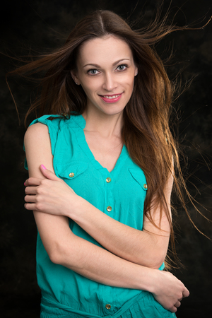 flying hair: young brunette woman with long flying hair, studio shot
