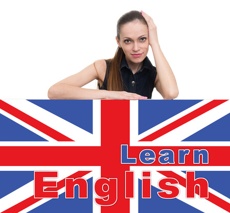 learning english: learning english concept. Attractive woman looking over top of banner Stock Photo