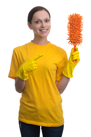spotless: Young woman with yellow rubber gloves preparing to clean