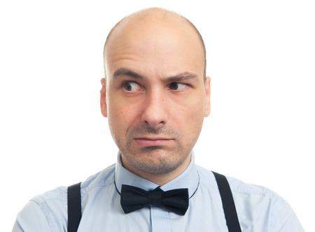 eyebrow raised: skeptical serious bald man looking away. Isolated