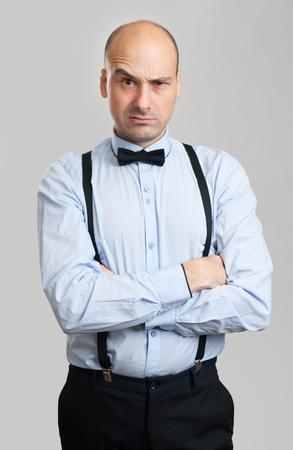 eyebrow raised: handsome stylish bald man raised eyebrow. Isolated on gray