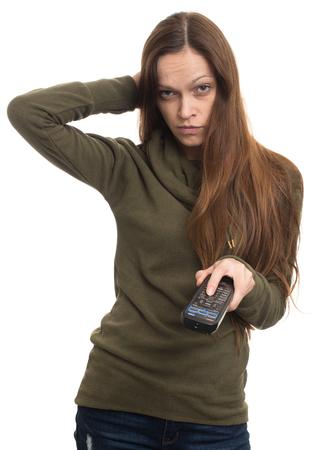 mujer viendo tv: mujer joven que ve la TV aislado en el fondo blanco Foto de archivo