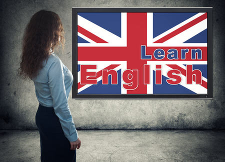 learning english: business woman rear view. Learning english concept
