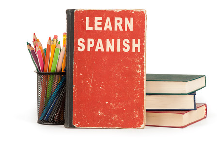 spanish language: learn spanish language. school supplies isolated on white background Stock Photo