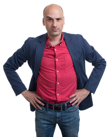business skeptical: skeptical bald man looking at camera. Isolated on white background