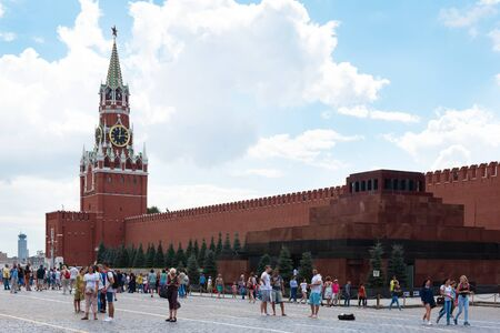 spasskaya: MOSCOW - August 04, 2016: Moscow Kremlin. Spasskaya Tower, Tourists on Red Square. Russia