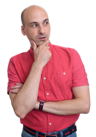 looking at side: surprised bald man wearing red shirt looking side. Isolated Stock Photo