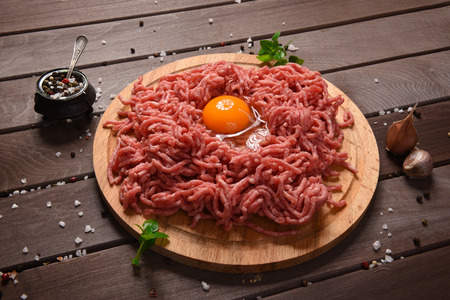 farce: minced meat on a rustic wooden desk Stock Photo