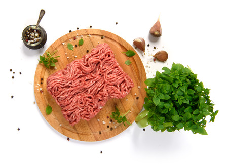farce: Minced meat on cutting board, top view. Isolated over white background