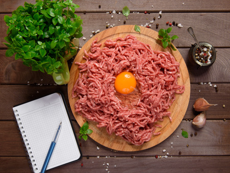 farce: minced meat on a rustic wooden desk. Cooking concept